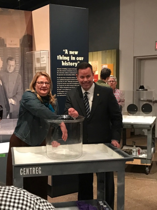 Kristen Froehlich of the Philadelphia History Museum and Mr. Adam Copp reaching into the Draft Lottery Bowl.
